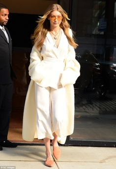 Chic: The supermodel, 22, kept her look fresh and chic while sporting an all-white ensembl...