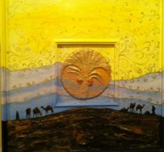 I had a lot fun creating this piece where I had created the center clay palm disc from air drying clay & combined it with this painting which was done on a wood panel painted with acrylics of a typical desert scene with some hills in the far horizon.
