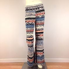 "20% OFF BUNDLESNWT Tribal Bell Bottoms Stretchy tribal bell bottoms in teal, coral, black & white. New with tags. Features fold over waistband, flared leg, & fabulous slinky soft fabric. Marked size XL, also great for a L. Waist:29"" unstretched; stretches confortably up to 35"". Rise:13"" unfolded; 10.5"" folded in half. Waistband height:6"". Hips:40-50"". Inseam:30"". Leg opening:16.5"". Total length:42.5"". #hippie #festival #boho #spring20% OFF ALL BUNDLES Blush Pants Boot Cut & Flare"