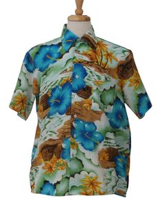 1970s -Van Cort- Mens blue, yellow, white green and brown palm tree, hibiscus flower, wave and grass hut design all over this polyester short sleeve Hawaiian shirt.  Button fron with fold over collar and one front left patch pocket. (Love the unusual colors on this one.)