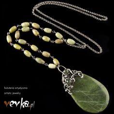 Materials: jade, kyanite, olivine fine and sterling silver.