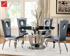 The Blasio Collection transforms your dining room in the Hollywood Bling & Glam style! The metallic grey chairs and black tempered glass table top truly make it one of the most unique sets in the market. (Items# 107881) #Decor #HomeDecor #HomeImprovement #HomeMakeover #HomeFurnishing #HomeGoals #InteriorDesign #Interior123 #InteriorDecor #HomeStyle #HomeInspiration #HomeInspo #DesignInspo #FurnitureDesign #HollywoodGlam #Bling #Glam #CoasterCompany #Coaster