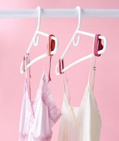 To keep your tops on your hangers and off the floor, simply put rubber bands on both sides.