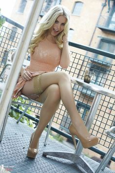 "WOW, this is certain to get someone into trouble!! Those hot legs wrapped in nude stay-ups, finished with nude heels, a beautiful lacy dress and gorgeous hair. A Perfect-10 ""CLASSY"" look that is absolutely Smokin' HOTT!!  Oh, and that smile?...What a babe!!"