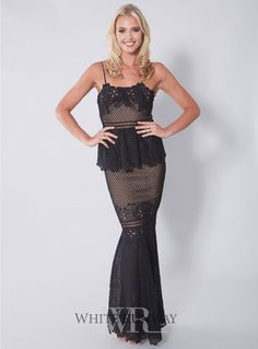 Frilling Around Gown. A stunning gown by Grace & Hart. A fitted lace style featuring a peplum on the waistline for a flattering fit.