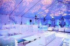 Stunning #winter #wedding. Icy blue #uplights, paired with a #gobo projector to create textured snowflakes on the ceiling. The all white furniture really completes the look! #RentMyWedding #weddinglounge