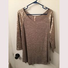 Gorgeous oatmeal colored sequin shirt Perfect top for Christmas or New Years parties. Simply stunning runs smaller more a 2x ⭐️⭐️⭐️⭐️I do not trade. Please feel free to make a reasonable offer and we can go from there. I love to bundle and the more items you have the more discount I will give. All sales final. Any questions please feel free to ask!!⭐️⭐️⭐️⭐️ Tops