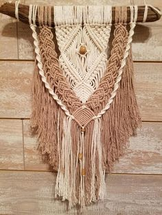 Handcrafted custom macrame wall hanging. Made from cotton yarn and hung from natural driftwood. Ready to hang in any room.