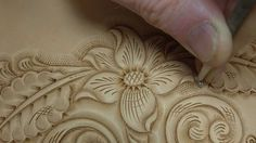 The concept is at least close enough to basic shading and wood burning that I think I could maybe swing it. And embossing leather isn't really leatherworking...right? Right? Tooling and Carving Leather https://www.youtube.com/watch?v=rfv3iQYDUgs