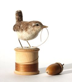 Needle felted wren on a vintage wooden spool.