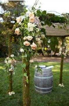 Country wedding apricot flowers on branch chuppah #themodernjewishwedding.com