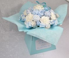 Baby Bouquet 19 items of Baby Clothes - Baby Shower Gift - Nappy Cake - Baby Boy. £29.99, via Etsy.