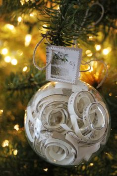 """Beautiful ornament for our first Christmas. Cut up a copy of our wedding invitation and put it in a glass bulb. Arrange the pieces so that specific sections of the invite would be visible such as, """"as they join hands in marriage"""", the date and time, our names,  etc..."""