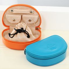 Our Travel Personalized Leather Half-Moon Zip-Around Jewelry Case is both petite and sweet. This contoured cutie was designed to provide maximum storage within a sleek half-moon shaped case. Jewelry keep includes a padded ring bar, two snap pockets for smaller delicate items, and a removable drawstring pouch for larger pieces. Available in Honeysuckle Pink, Mandarin Orange, Teal, Blue Curacao, Cornsilk Yellow and Sugar Coral. Measures 5.25 by 3.5 by 1.5 inches.