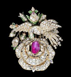 A fine Qajar gem-set and enamelled gold Brooch in the form of a bird on a rose Persia, 19th Century