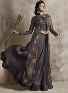 Here is a beautiful three piece set in elegant grey colour. its blouse , lehenga and jacket are in grey colour. Its blouse and lehenga are fabricated on satin linen paired with organza fabricated printed jacket. Kurta Neck Design, Saree Blouse Neck Designs, Lehenga Designs, Blouse Designs, Party Wear Gowns Online, Party Wear Dresses, Lehnga Dress, Lehenga Gown, Lehenga Blouse
