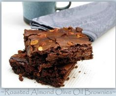 OLIVE OIL BROWNIES with ROASTED ALMONDS ||||||||||||||||||||||| 1/22 - made them for game night with the girls - and I love them. Didn't have enough sliced almonds so I filled the rest with roasted pumpkin seeds. Used Baker's Unsweetened Chocolate squares. A bit on the crumbly side, not super moist, but delicious nonetheless. I'd make them again.