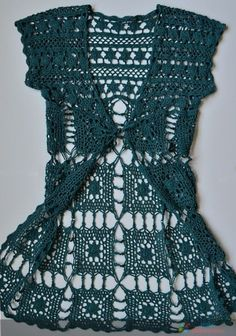 How to Crochet a Little Black Crochet Dress Long vests create a long lean line, every women desires. This kid of vest works great with skinnies as well as with a sh. Gilet Crochet, Crochet Jacket, Crochet Cardigan, Crochet Shawl, Knit Crochet, Crochet Vests, Crochet Sweaters, Crochet Stitches, Crochet Tops