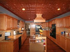 Not everyone can afford solid copper in their kitchen but there is an alternative.  Faux copper ceilings are very popular as they save money and are light weight.. Visit our website and view wide selection of Faux copper tiles and installation instructions.
