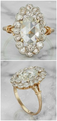 A vintage engagement ring from the Edwardian era, circa 1910. With a 1.98 carat rose cut center diamond and a halo of 18 old European cut diamonds in platinum and gold.
