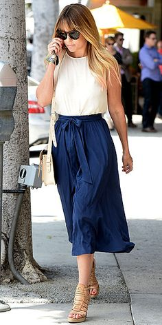 """LAUREN CONRAD File this outfit under """"Meeting the Boyfriend's Parents"""" or """"Drinks with the Boss"""" or """"Might Run Into Ex with His New Girlfriend."""" Basically anytime you want to come off as poised and polished. Lauren does just that in a navy bow-front skirt (from her Paper Crown line), a sleeveless white top, a Cambridge satchel and nude sandals."""