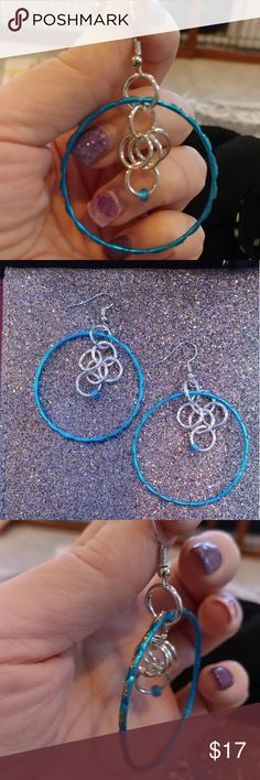 Handcrafted mini hoop dangle earrings I just made these earrings prior to this posting! They are made using very small lightweight bracelets that are a metallic teal blue and I've added silver links reclaimed from a bikini top! I've added a glass teal bead for balance. These are definitely unique! ! If you like these earrings, click on the BUNDLE button at the bottom of this listing, and I will send you a special offer! handcrafted by me using reclaimed items Jewelry Earrings