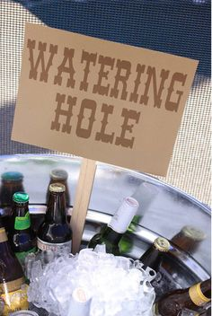 Cowgirl themed party - watering hole.  I would use barn board and stencil the words on it.