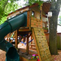 Backyard tree fort with slide and a tire swing