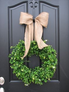 I like this idea for St. Patrick's Day. Also reminds me to paint my hanger to match the door.    love the black door