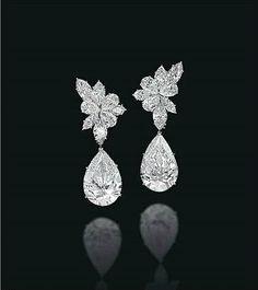A pair of diamond ear pendants, by Harry Winston