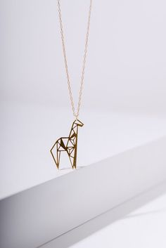 valentines off MIZYAN's geometric giraffe necklace, origami giraffe necklace, geometric accessories Cute Jewelry, Unique Jewelry, Jewelry Accessories, Fashion Accessories, Giraffe Tattoos, Geometric Giraffe Tattoo, Disney Couture Jewelry, Giraffe Necklace, Origami Tattoo