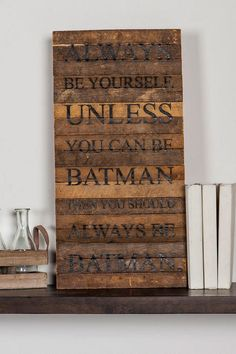 """Always be yourself. Unless you can be Batman, then you should always be Batman.""<br /> <br /> A little humorous inspiration goes a long way! This wooden wall art is ideal for a dorm room or small apartment!<br /> <br /> - 24"" length x 12"" width<br /> - Standard shipping only<br /> - Imported<br />"