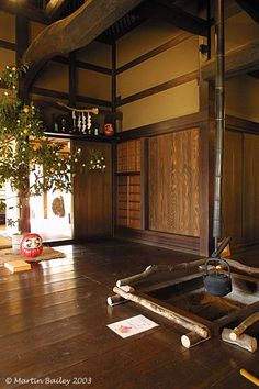 Edo Era Japanese Living Room - Koganei, Tokyo...with a pretty big Daruma doll by the front door. #japanesearchitecture