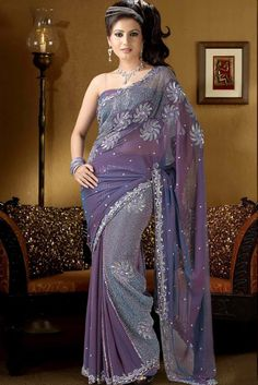 Here View Indian designer sarees for women.Get all indian sari latest and new indian sarees styles.Get latest indian saree collection 2012-2013.For all new and latest indian sarees for women visit http://fashion1in1.com/asian-clothing/latest-saree-designs-latest-indian-sarees-styles
