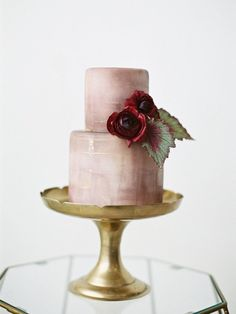 Mauve two tier wedding cake: Photography: Jamie Rae - http://jamieraephoto.com/ - pink nude tiered lavish wedding cake on a gold cake stand
