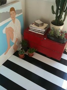 """seriously budget-friendly linoleum tiles ($0.59 per sq. ft) look majorly luxe by cutting them in half and laying them in a striped pattern."" Design Sponge"