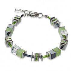 Coeur De Lion Geo Cube green and Grey Coloured Bracelet. This bracelet is made of combination of cubes using with swarovski elements and acrylic glass set in white-bronze alloyed steel and fine glass rods. N.B do not spray with perfume. Model Ref:4330A