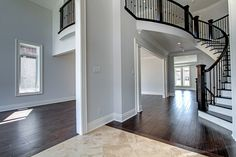 Solid oak circular staircase with iron pickets   1120 Kent Avenue, Oakville