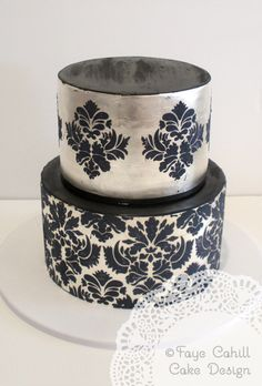Striking stencil damask detail over silver tiers, by Faye Cahill Cake Design