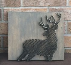 String Art - Buck silhouette, black on grey stained board.  Made to order through my Etsy shop, NailedITCA.  Check it out for unique home accents and art.