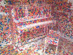Piano covered in sticky dots at GOMA