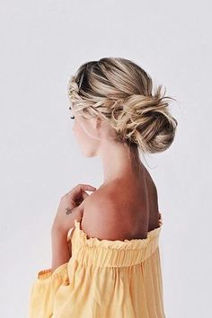 This braided updo with loose messy bun would be beautiful for wedding hair.