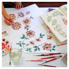 It's time to paint. We've been looking through our reference library in the studio for some classic floral inspiration, and we've got the gouache out working on some soft feminine floral prints.