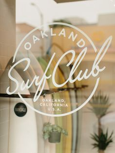 Oakland Surf Club - type over a guassed photo, nothing new but I like it. It marries a sport not normally thought of as classy or elegant with that of an exclusive member's only club. Or it could be for a restaurant, it's that generic in design. It has some great elements none-the-less, the 50's script, the feel that it's the end of day roll in to the Surf Club for something good  . . .