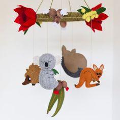Australian animal baby mobile featuring kangaroo, koala, possum and echidna with Australian wildflowers and gumleaves by BabesintheWoodsShop on Etsy https://www.etsy.com/au/listing/467809631/australian-animal-baby-mobile-featuring