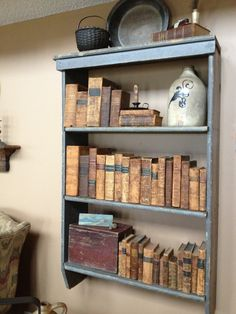 FARMHOUSE – INTERIOR – early american decor inside this vintage farmhouse seems perfect, like these old leather books.