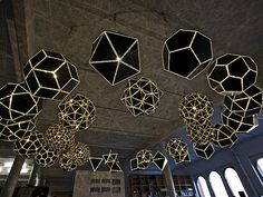 """Designer and artist Olafur Eliasson's """"Your Sound Gallery"""".  The installation is comprised of 27 polihedra, hanging from the ceiling and carefully arranged in two concentric circles."""