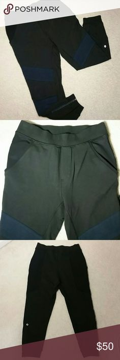 """Sz 4 Lululemon capri joggers RARE black with navy This is a great pair of joggers in like new condition! They have front pockets as well as 1 back pocket. There are zippers at the bottoms as well as the jogger band. There are 2 navy """"patches"""" on each leg in the front....the back is solid black. lululemon athletica Pants Track Pants & Joggers"""