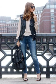 Fall outfit: leather biker vest, loose blouse, skinny jeans, black heels, black Givenchy Nightingale bag
