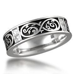 Renaissance Eternity Wedding Band - A unique wedding band that incorporates a Medieval sword inspired eternity symbol in the band. Eight channel set princess cut diamonds are set in pairs evenly spaced around the band. 6mm wide. 0.64 ctw ideal cut accent diamonds.